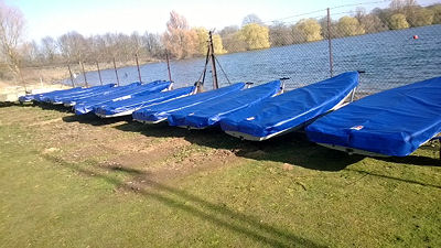 A fleet of tera dinghys all with Rainandsun covers.
